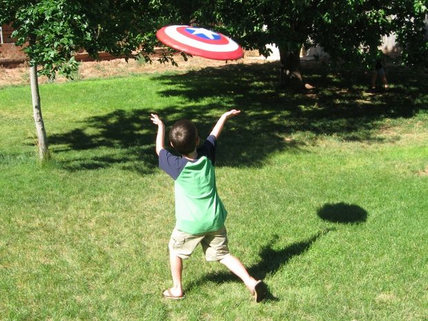 Boy Tries to Catch Captain America Frisbee Shield