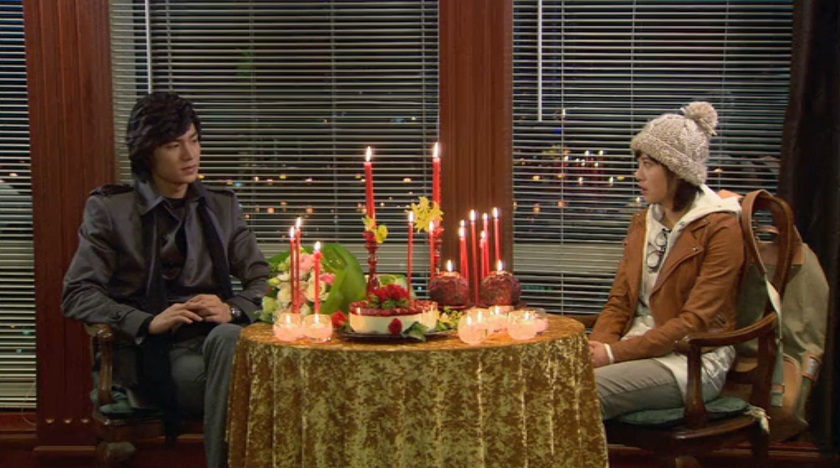Jan-di and Jun-pyo sit awkwardly in Boys Over Flowers episode 16