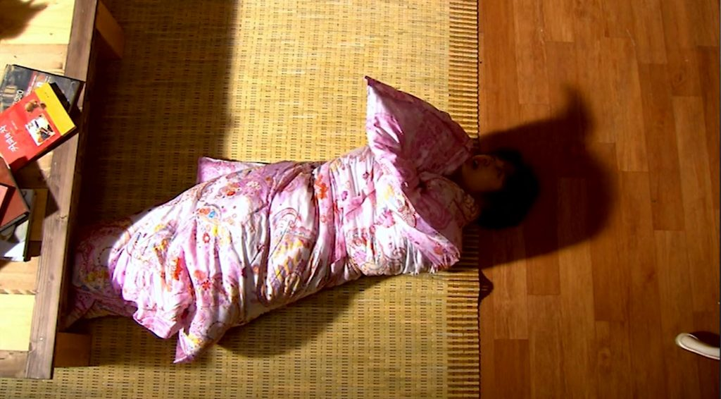 Eun-chan emerging from a sea of blankets