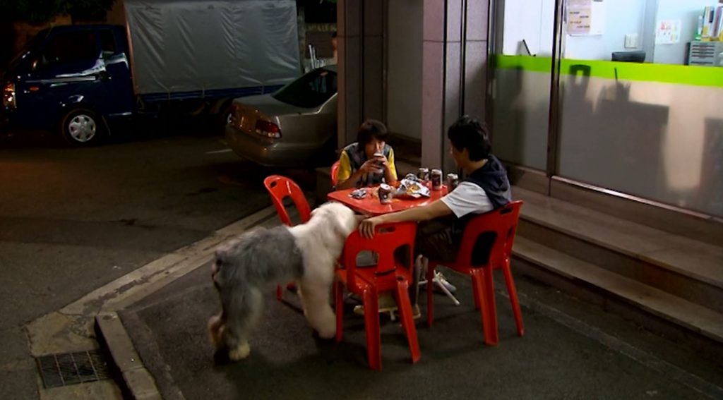 Sweeper, Han-sung, and Eun-chan at an outdoor food table