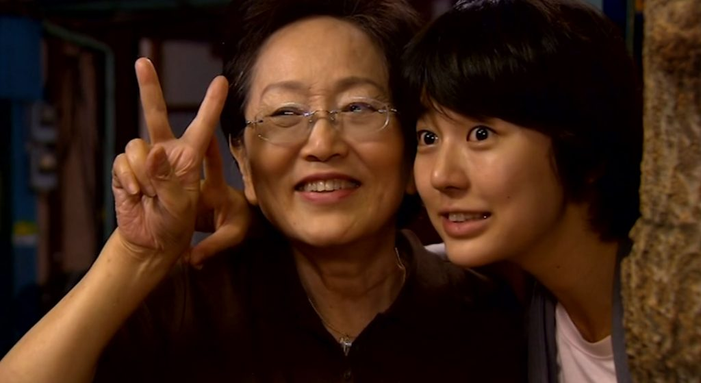 Grandma and Eun-chan posing for a picture